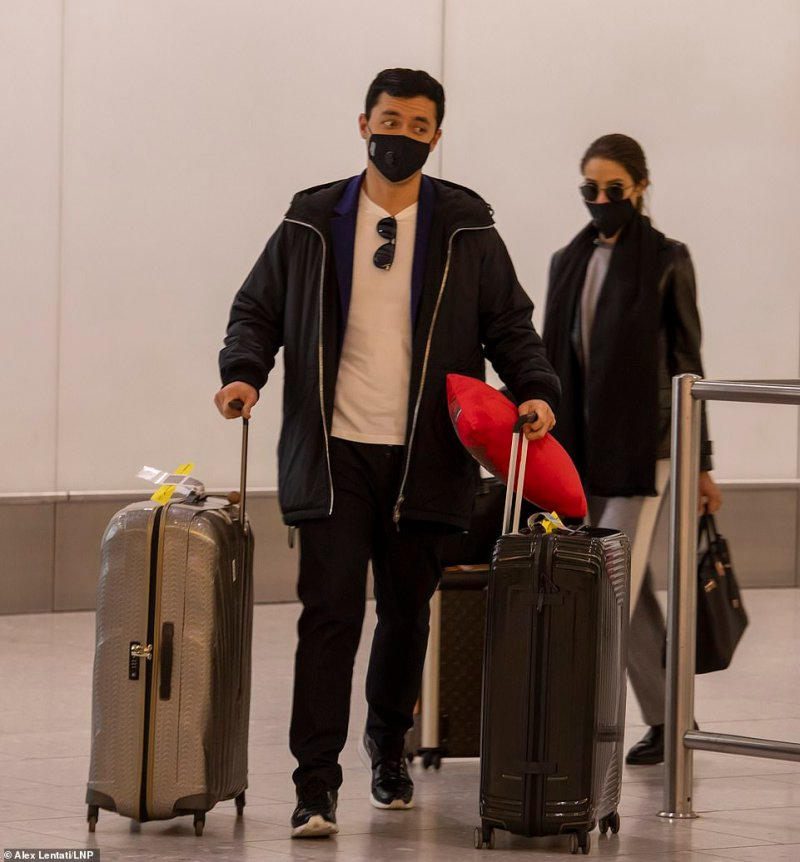 Passengers this morning arrived at Heathrow Airport wearing protective masks over fears of the Wuhan coronavirus outbreak