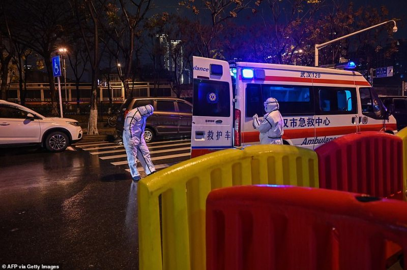 The virus-hit Chinese city of Wuhan, already on lockdown, banned most vehicle use downtown and Hong Kong said it would close schools for two weeks as authorities scrambled Saturday to stop the spread of an illness that has infected more than 1,300 people and killed 56 (pictured, medics at Wuhan Red Cross Hospital)