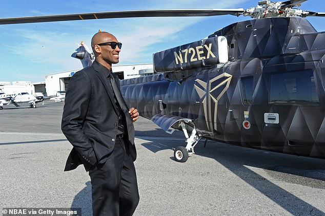 Bryant is seen preparing to board a helicopter in Los Angeles in April 2013
