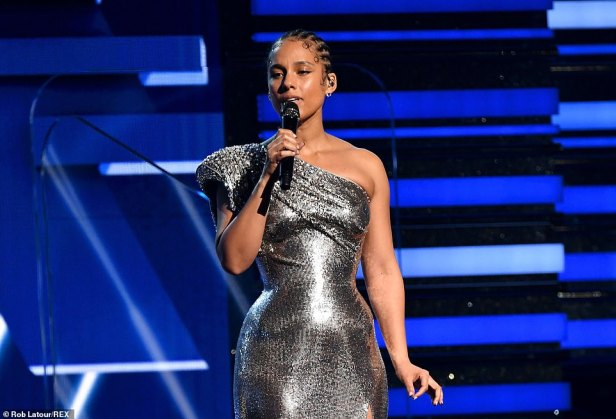 Moving: Alicia Keysgave an emotional monologue before the performance in front of the star-studded crowd at the Staples Center in Los Angeles, California on Sunday night