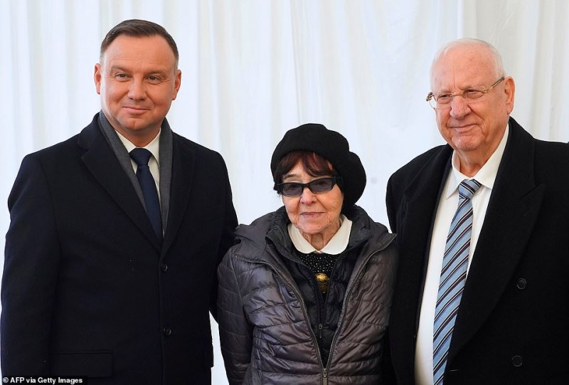 Polish President Andrzej Duda (L) and Israel's President Reuven Rivlin (R) stand next to Zofia Optulowicz (C), daughter of Polish Auschwitz hero Witold Pilecki.During World War II, Pilecki volunteered for a Polish resistance operation that involved being imprisoned in the Auschwitz concentration camp in order to gather intelligence that he sent to the Western Allies