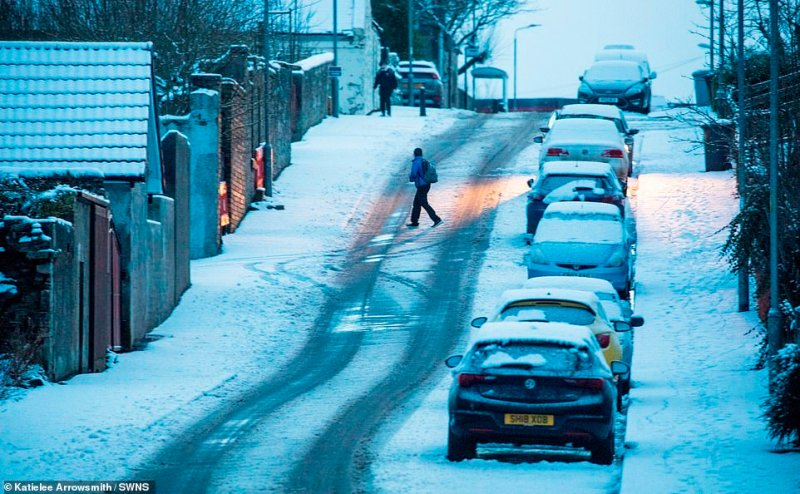 Commuters are being warned of travel chaos from ice and snow across Britain today, with three weather warnings having been issued by the Met Office, snow above in Lanarkshire