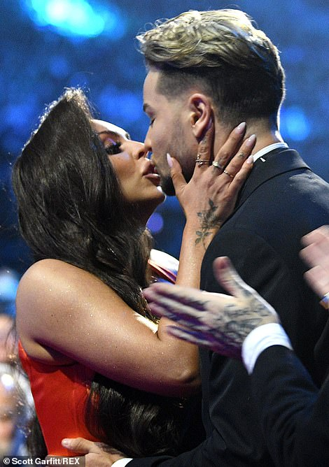 Celebratory: Chris was on hand to help Jesy celebrate her win before things took a downward turn