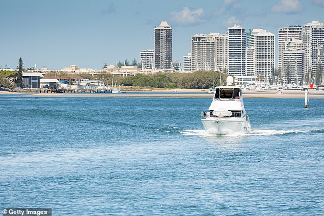 Every week up to 49,000 people are landing in Australia on 167 flights from China, where 170 are dead from coronavirus and more than 7,700 infected. Many are heading to holidays spots such as Queensland's Gold Coast (pictured)