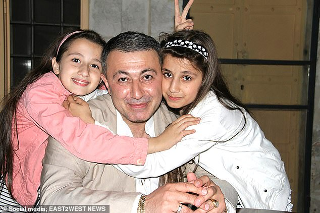 The three sisters say they acted in self-defence when they killed Mikhail Khachaturyan (pictured here with two of the girls when they were younger) after years of 'sexual abuse'