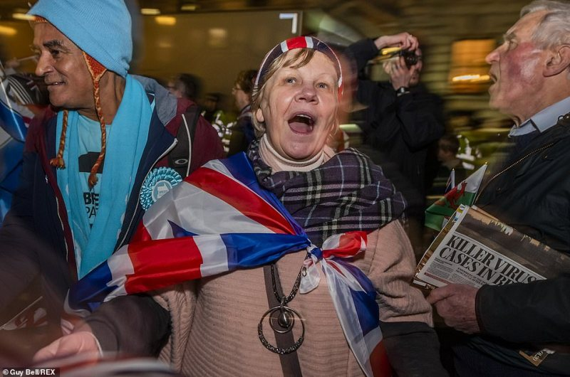 A woman celebrates Brexit Day with a Union flag wrapped around her shoulders.From Cornwall to Yorkshire and Newcastle, celebrations have commenced