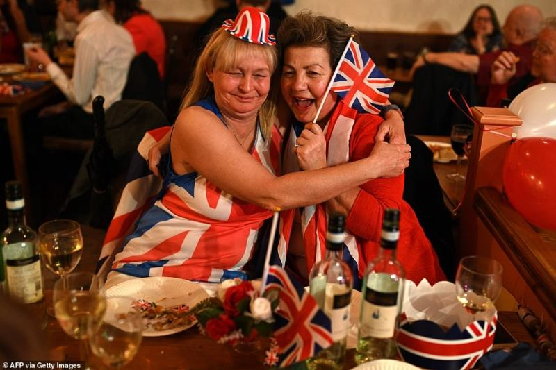 Brexit supporters embrace during a Brexit Celebration party at Woolston Social Club in Warrington.From the central Leavers party in London's Parliament Square, to the social clubs of Warrington in the North West, merry revellers waved Union Jack and and wished each other a 'happy Brexit day'
