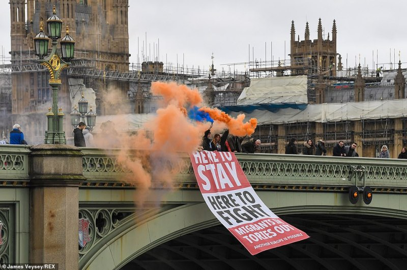 A pro EU banner is dropped from Westminster Bridge ahead of the UK's formal exit from the EU this evening