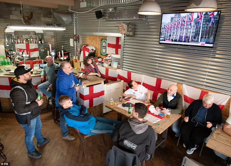 People watch a news report on Brexit at the Sawmill Bar in South Elmsall, Yorkshire, where a Brexit party is being held throughout the day ahead of the UK leaving the European Union at 11pm this evening