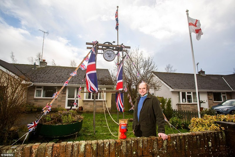 Dave Tyrrell, 69, has erected his own 'Brexit Bell' which he will ring this evening at 11pm in celebration of the UK leaving the European Union.A 15ft tower erected out of scaffolding poles and Union Jack flags, is installed in his hometown of Lympstone, Devon