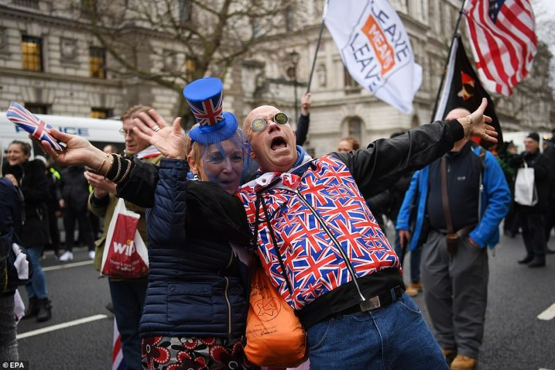 Pro Brexit supporters celebrate outside the Houses of Parliament in London this evening. Thousands are expected to gather to bid farewell to the European Union - which Britain will officially exit at 11pm