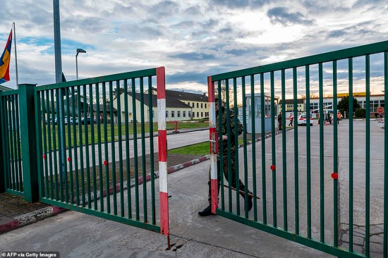 A soldier closes the gate at the entrance of a military base in Germersheim, near Stuttgart in southwestern Germany today where German citizens evacuated from Wuhan, epicentre of the coronavirus outbreak, will be held in quarantine