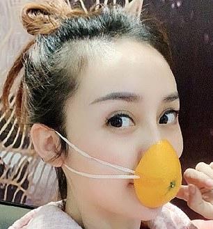 A girl wearing a home-made orange-peel mask