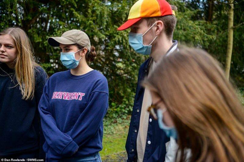 Students wear face masks around campus at the University of York today as fears heightened over the spread of coronavirus