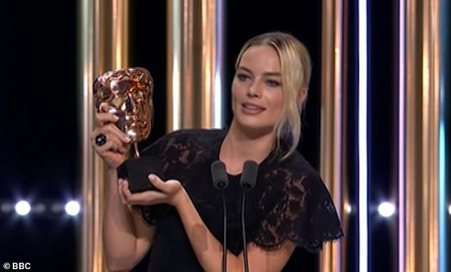 'I'm calling it Harry': Margot Robbie read out a speech on behalf of co-star Brad Pitt when she collected his Best Supporting Actor BAFTA, pictured. She said: 'He says he is going to name this Harry because he is really excited about bringing it back to the States with him'