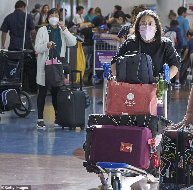 Passengers arriving at Auckland International Airport on February 5 wore face masks as news spread that an evacuation plane was incoming
