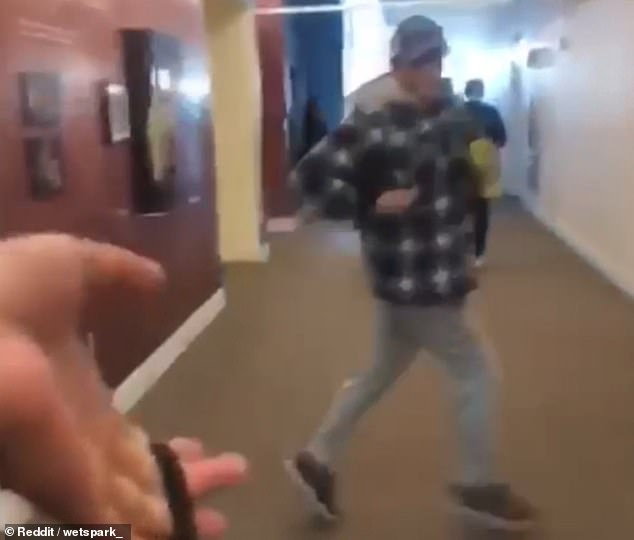 When he is kicked out the room, Kingery repeatedly stomps on a student's laptop bag