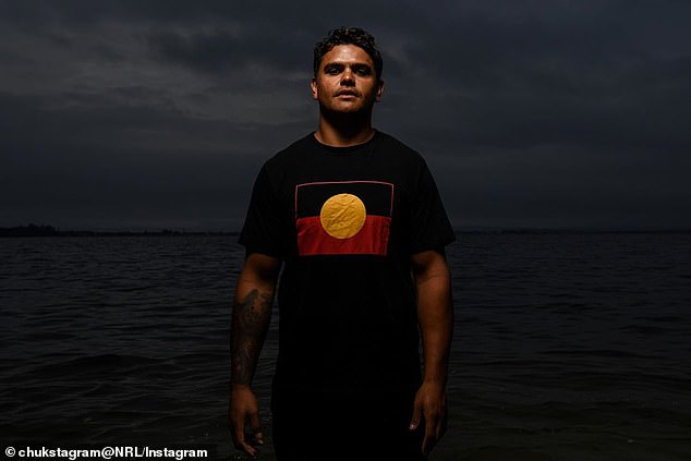 On Wednesday, Mitchell shared an impassioned tribute to his Aboriginal culture alongside a photo (pictured) of him wearing a T-shirt bearing the indigenous flag. A day later, the ARL Commission is expected to scrap Advance Australia Fair from the All Stars game on February 22