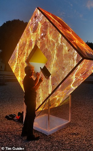 Mr Guider works on his light sculpture 'Enlightenment' which won a 2017 Florence Biennale Contemporary Art Award gold medal