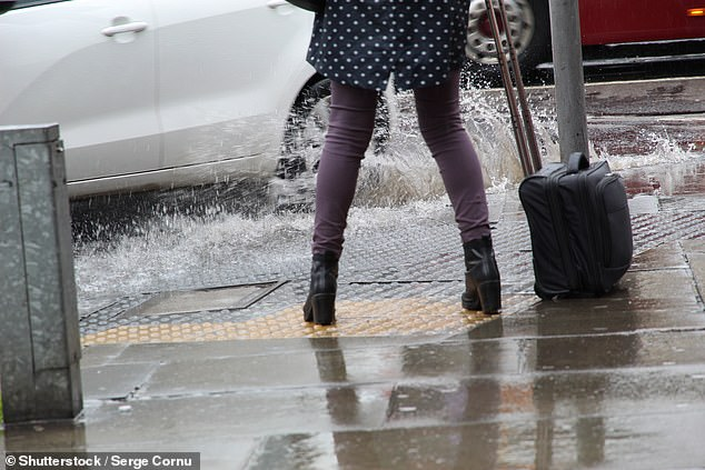 New South Wales motorists can cop a fine of $191 if they're caught driving through a puddle and splash mud on a pedestrian at a bus stop (stock)
