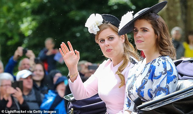 Her Majesty would like her granddaughters, Princess Beatrice (left) and Princess Eugenie (right), to carry out more duties, according to a courtier. The sisters are pictured in a carriage as they travel to the House Guards Parade during the Trooping the Colour ceremony in 2019