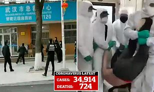 Video shows officials in protective suits dragging suspected ...