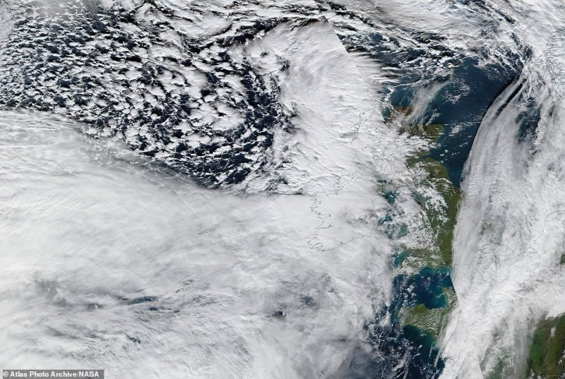 In Scotland, officials put in place a 40mph speed limit on the Queensferry Crossing, and ferry services were also cancelled after strong winds. Pictured: A satellite image shows clouds covering all of Northern Ireland and a large part of Scotland