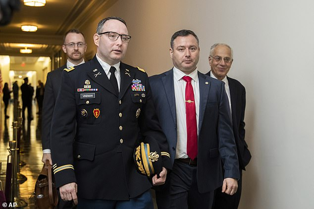 National Security Council aide Lt. Col. Alexander Vindman, left, and his twin brother, Yevgeny Vindman, right, in November of last year