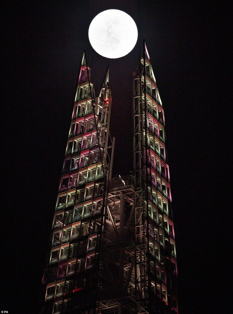 The moon was pictured shining brightly in the sky above London's Shard building on Saturday evening