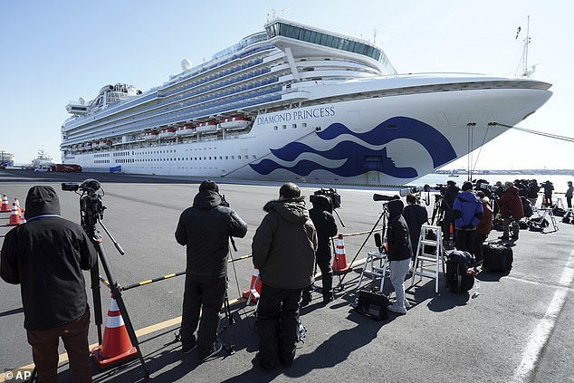 The Diamond Princess is anchored off the port of Yokohama on February 9