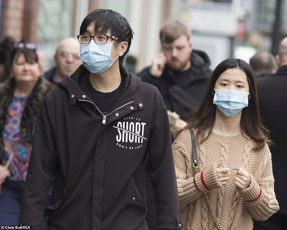 A man and a woman wearing face masks in Manchester city centre last week
