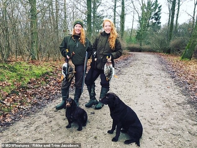The pair say hunting animals has brought them closer together. They are pictured with ducks they killed near their home in Ry, Denmark