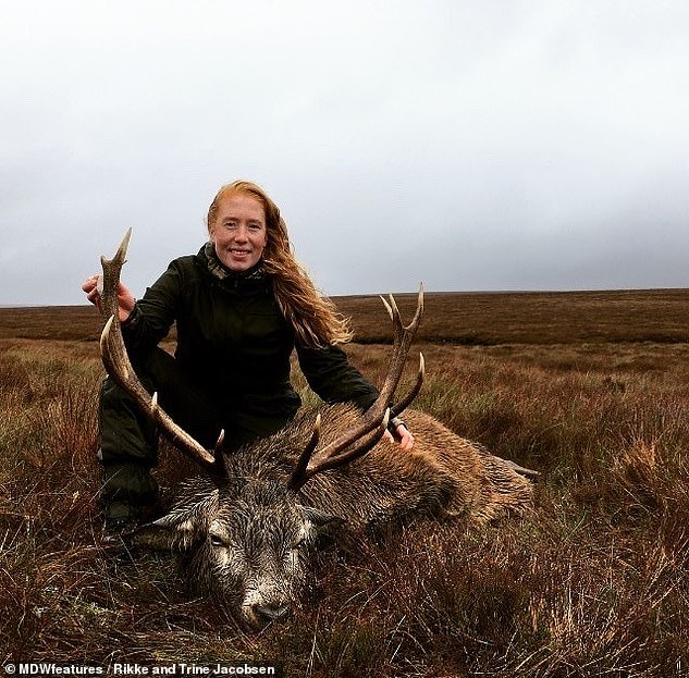Rikke pictured with a red stag she hunted. She said she can't forget how her sisters smile stretched 'from ear to ear' when she killed her first red stag in the Scottish Highlands