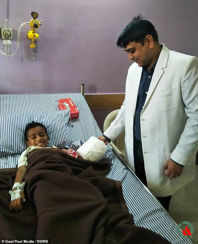 Dr Abhishek Ghosh treated Shaurya at Noble Hospital inManjri, India.He said: 'Seeing the young age of the child it was decided to attempt to salvage the hand'