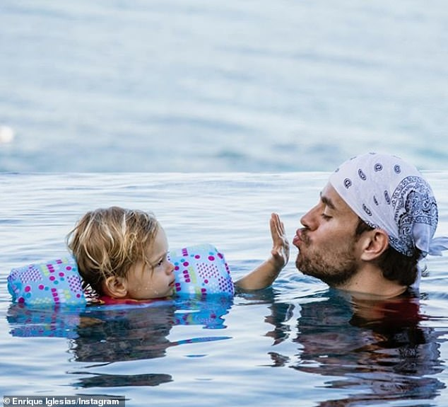 Dad: Enrique and Anna have yet to share any such baby news on their Instagram accounts, but the singer shared a shot of himself swimming with one of his offspring last month