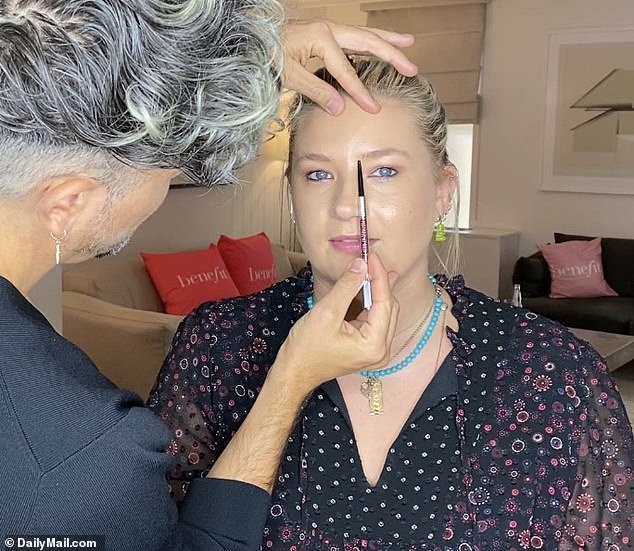 Step one: Use the brow pencil to measure straight up from the dimple of your nose. This indicates where the brow should begin