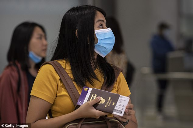 Thailand was the first country outside of China to declare a case of the coronavirus, on January 13. Pictured, a woman wearing a mask at an airport in Bangkok