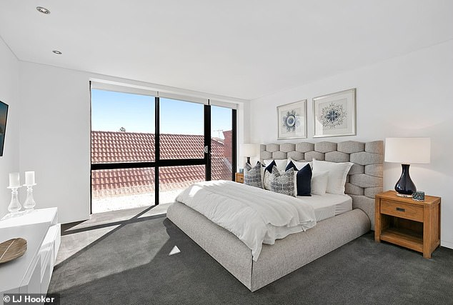 Bachelor pad:The three-bedroom property has floor-to-ceiling glass windows looking out over Bondi Beach and the Pacific Ocean