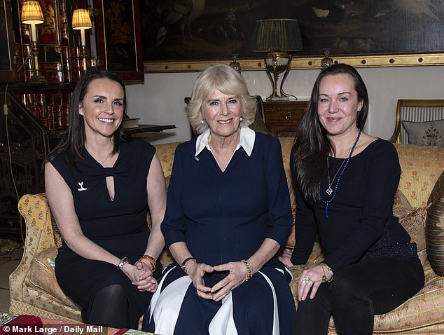The Duchess of Cornwall talks with SafeLives pioneers Rachel Williams, whose ex-husband shot her in 2011, and Celia Peachey, whose mother was also killed by her partner, after hosting a reception at Clarence House to acknowledge the 15th anniversary of domestic abuse charity SafeLives