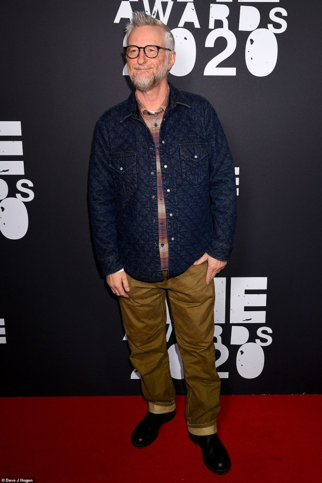 Musician: Billy Bragg opted for a laid back look in a navy jacket and tan trousers as he arrived on the red carpet
