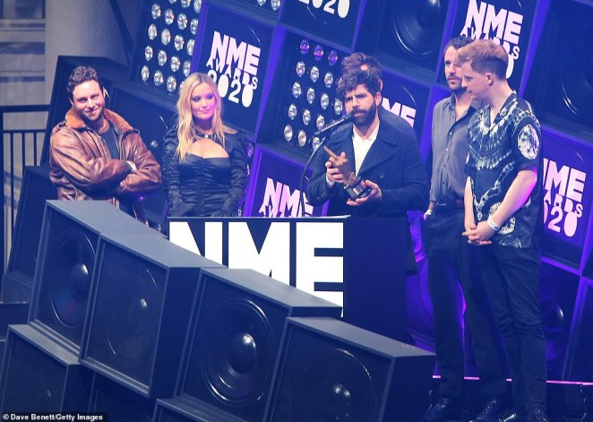Thrilled:Yannis Philippakis of Foals accepted the Best Live Act award on stage alongside Laura Whitmore