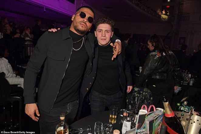 Party goers:: Kola Bokinni and Dylan Llewellyn posed for a snap at the star-studded awards show