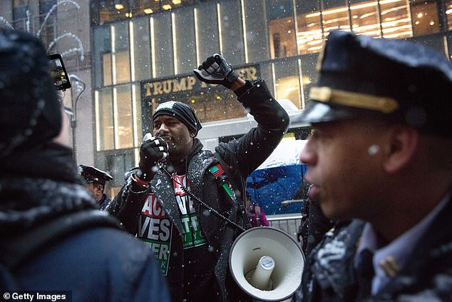 Black Lives Matter activist Hawk Newsome, who refused to condemn protesters rioting at anti-cop demonstrations, rallies activists in front of Trump Tower on January 14, 2017 in New York