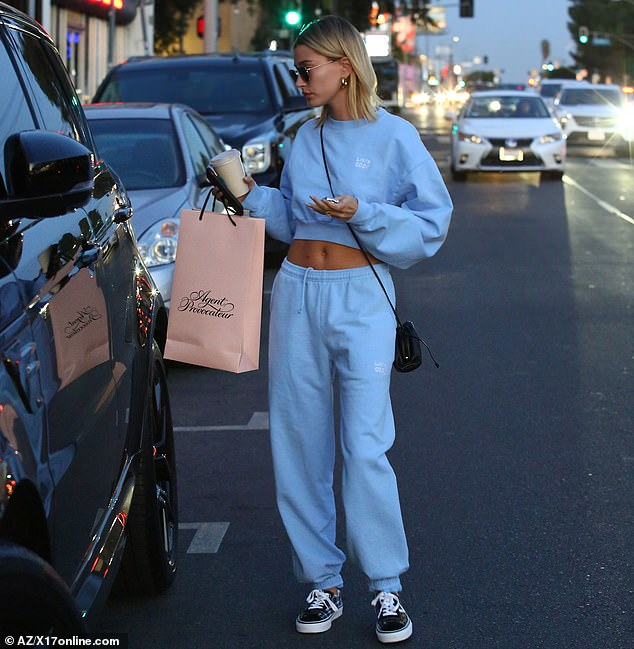 Accessories: The 5ft7in model had a small black handbag with an ultra-thin strap slung over one shoulder, and she covered her face with a pair of military-style square aviator sunglasses