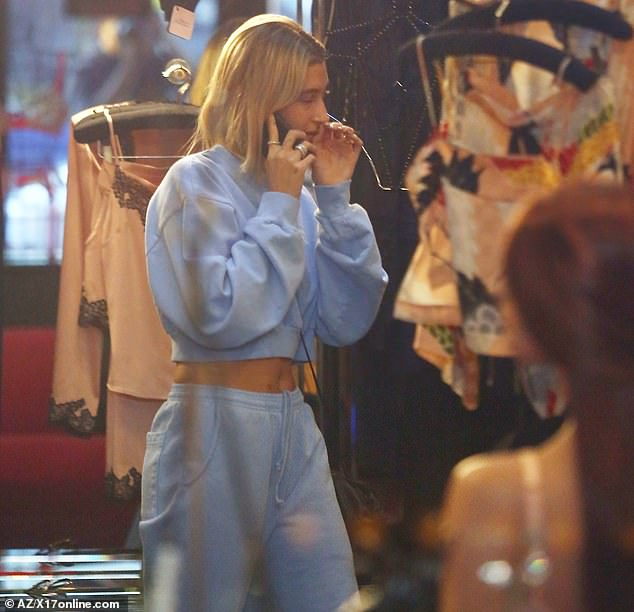 Making her pick: Hailey was seen sans her sunglasses inside the store as she perused the alluring merchandise