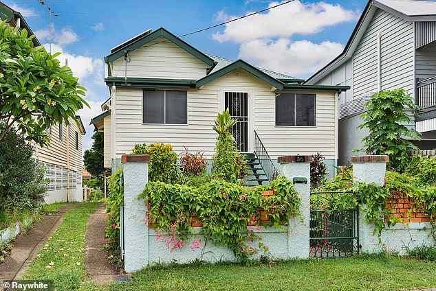 Brisbane was also seen as a good prospect, with house prices tipped to rise by 8 per cent, which would see the median climb from $577,664 to $620,000. Pictured is a house at Annerley being offered at auction