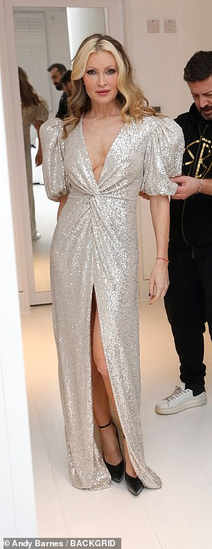 Golden girl: Caprice also dazzled in a glittering puffball dress that she teamed with toweringly high black heels