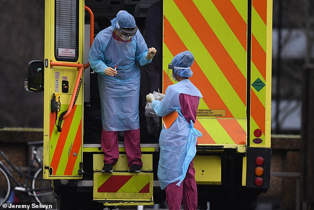 An ambulance pulled up at St Thomas's Hospital in London his morning where it was met by two staff in protective gear