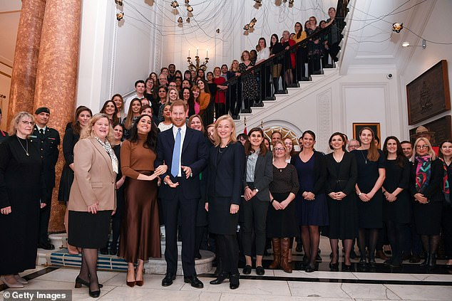 Prince Harry, Duke of Sussex and Meghan, Duchess of Sussex stand with the High Commissioner for Canada in the United Kingdom, Janice Charette (4thL) and the deputy High Commissioner, Sarah Fountain Smith (7thL), as they pose for a photograph with High Commission staff at a Canada House visit in January
