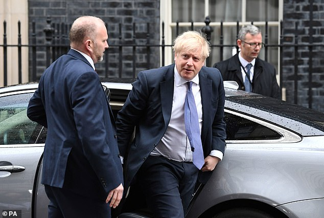 Boris Johnson, pictured in Downing Street yesterday, conducted a brutal reshuffle of his Cabinet